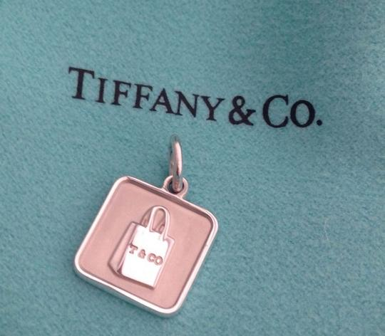 Preload https://item1.tradesy.com/images/tiffany-and-co-sterling-silver-lexicon-t-and-co-bag-charm-972590-0-0.jpg?width=440&height=440