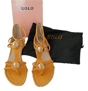 Other Soft Rolled Straps Large Medallions Sophisticated Comfortable Ocher Sandals