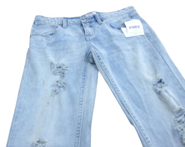 Preload https://item3.tradesy.com/images/free-people-light-wash-distressed-skinny-jeans-size-28-4-s-975362-0-0.jpg?width=400&height=650
