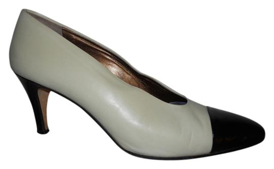 Preload https://img-static.tradesy.com/item/9768589/cole-haan-beige-and-black-vintage-two-tone-classic-pumps-size-us-95-regular-m-b-0-1-540-540.jpg
