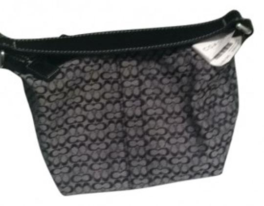 Coach Satchel in black and silver