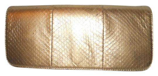 Preload https://item4.tradesy.com/images/giani-bernini-gold-snakeskin-faux-leather-clutch-979153-0-0.jpg?width=440&height=440
