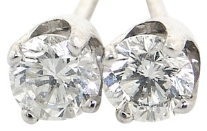 ABC Jewelry 1-14kt white gold diamond studs set with two matching genuine brilliant cut diamonds with a total weight of .78ct.