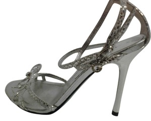 Guess By Marciano Sexy Ankle Strap Silver Hardware Rhinestone Iconic G Strappy Toe Bow W/ 3 Rhinestones Silver Metallic Sandals