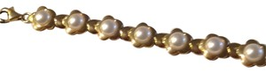 14 ct Gold with real pearls Tennis Bracelet. !4 ct Gold with pearls Tennis Bracelet .