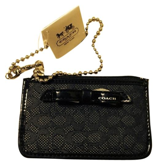 Preload https://item2.tradesy.com/images/coach-black-skinny-card-coin-case-wallet-983156-0-0.jpg?width=440&height=440