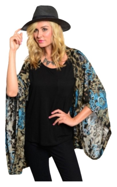 Preload https://img-static.tradesy.com/item/9837451/teal-pattern-loose-fit-animal-print-ponchocape-size-os-one-size-0-1-650-650.jpg