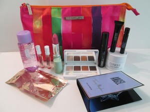 Clinique Clinique gift set bundle deal includes: NWOT, never used. 1 Clinique Large cosmetic bag dark pink, orange, red, yellow, green colors., makeup, skincare, 2 Jimmy Choo sample tube fragrances, 1 Angel sample tube fragrance!.