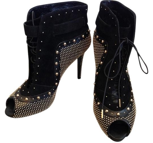 Preload https://img-static.tradesy.com/item/9846685/alexander-mcqueen-black-and-gold-studs-holiday-sale-us-9-95-new-studded-bootsbooties-size-us-9-0-1-540-540.jpg