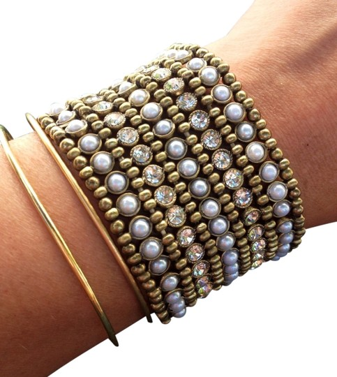 Preload https://item2.tradesy.com/images/new-faux-pearl-and-crystals-brass-stretch-cuff-bracelet-985721-0-0.jpg?width=440&height=440