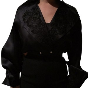 Escada Couture silk blouse with chemise. Detailed collar and cuffs. Size 34. There is a matching wool short skirt also listed seperately. Top Blac
