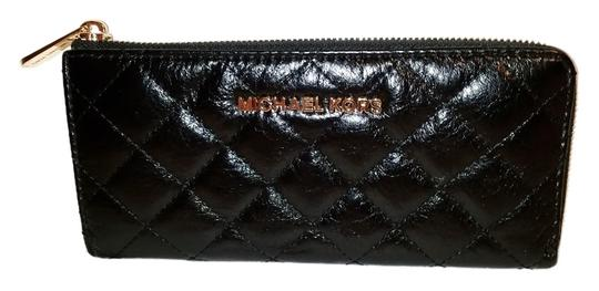 Preload https://img-static.tradesy.com/item/9873745/michael-kors-black-quilted-leather-clutch-0-1-540-540.jpg
