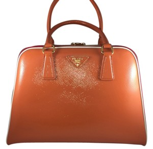 Prada Classic Calfskin Bowler Patent Leather Structured Rare Satchel in Orange (Papaya) base with Red side panels and White trim