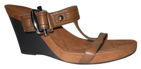 Preload https://item5.tradesy.com/images/nine-west-tan-leather-wedge-sandals-size-us-75-990924-0-0.jpg?width=440&height=440