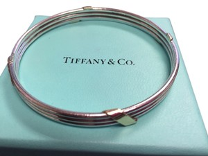 Tiffany & Co. Tiffany & Co. Bangle Sterling Silver with Gold Accents - medium