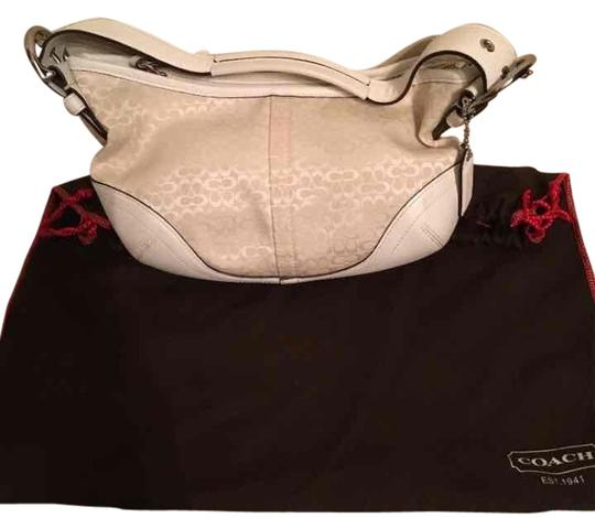 Preload https://item2.tradesy.com/images/coach-small-off-white-canvas-with-leather-trim-hobo-bag-9931741-0-3.jpg?width=440&height=440