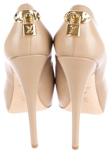 Louis Vuitton Tan Nude Leather Gold Gold Hardware Lv Logo Monogram Lock Charm Embellished Peep Toe Platform Stiletto Hidden Platform Beige Pumps