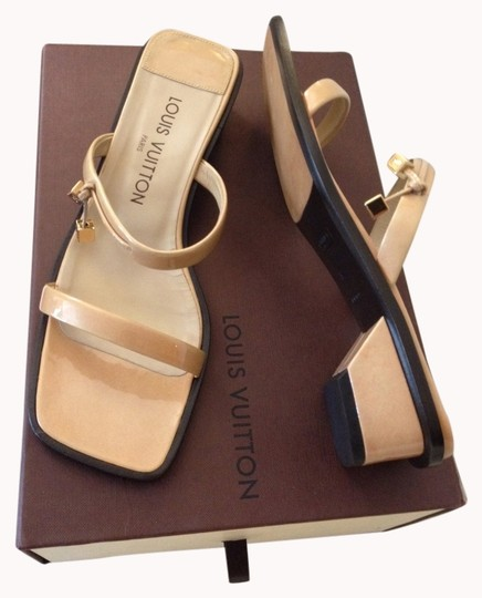 Preload https://item1.tradesy.com/images/louis-vuitton-tan-patent-leather-like-new-size75-slides-flats-size-us-75-993615-0-0.jpg?width=440&height=440