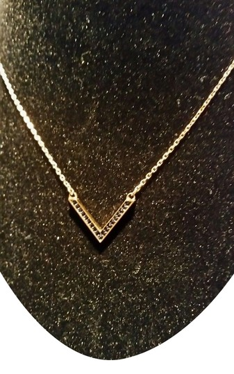 Preload https://item3.tradesy.com/images/michael-kors-gold-tone-black-v-pendant-crystals-new-with-tags-and-pouch-necklace-9960802-0-1.jpg?width=440&height=440