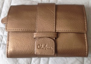 Cole Haan Metallic Jewelry Organizer Bronze Clutch