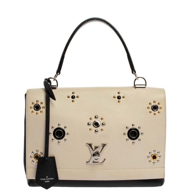 Item - Lockme II Black/White Leather Mechanical Flower Bag Wristlet