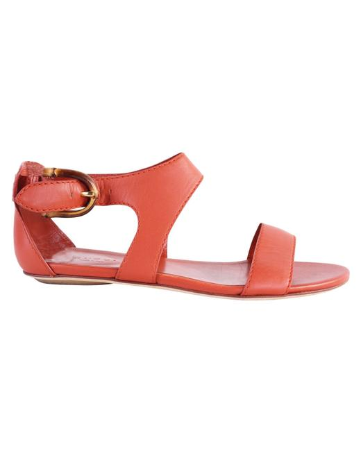 Item - Orange Leather Flats with Bamboo Buckle Sandals