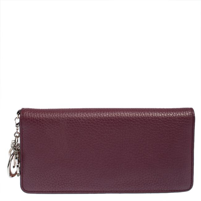 Item - Plum Leather Voyager Bifold Continental Wallet